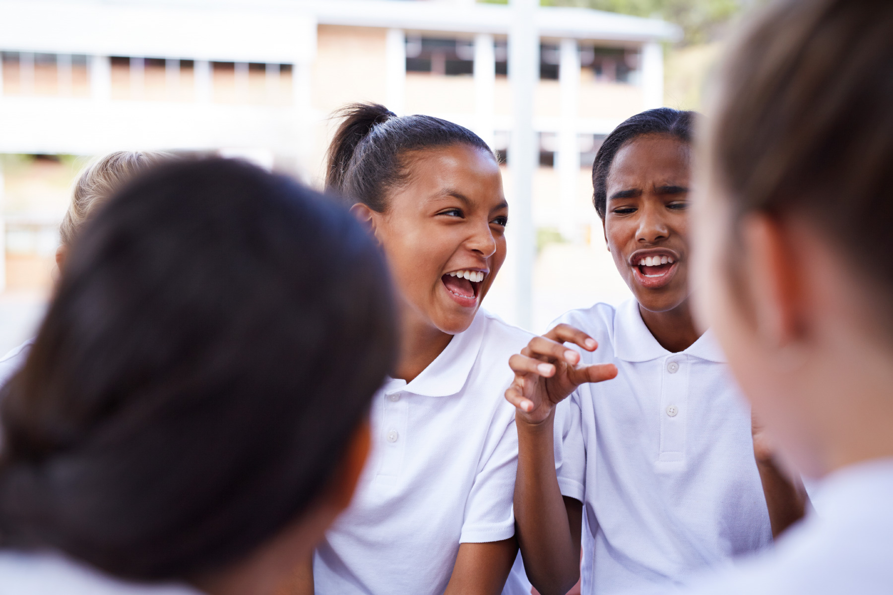 Group of friends laughing in schoolyard