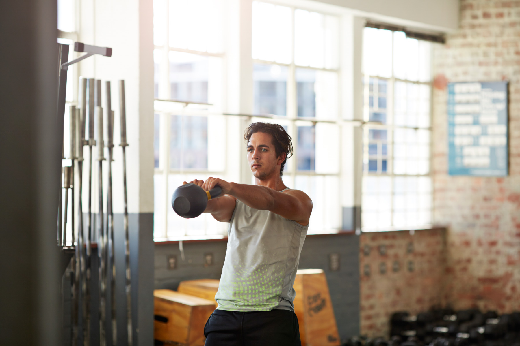 Man exercising with Kettlebell in crossfit gym