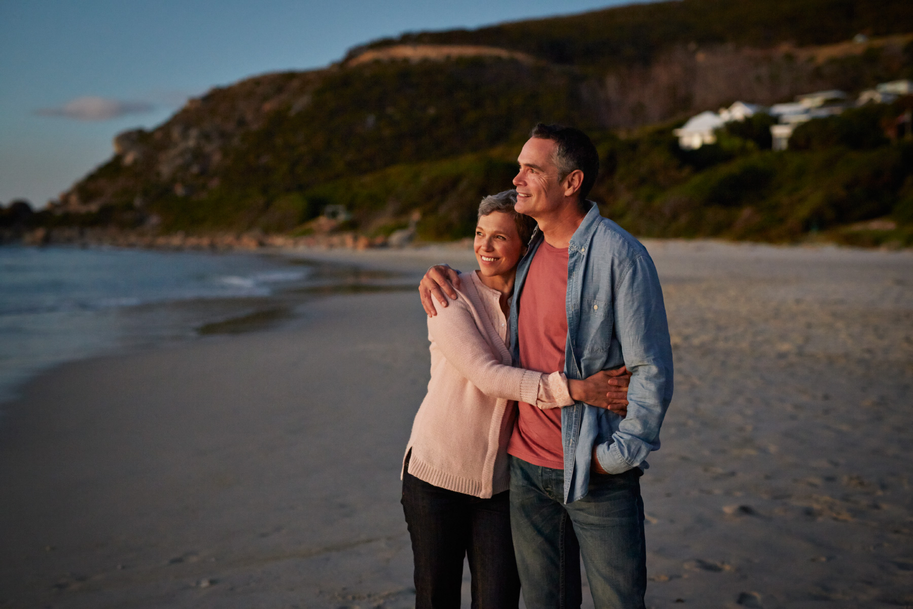Senior couple enjoying the sunset at beach