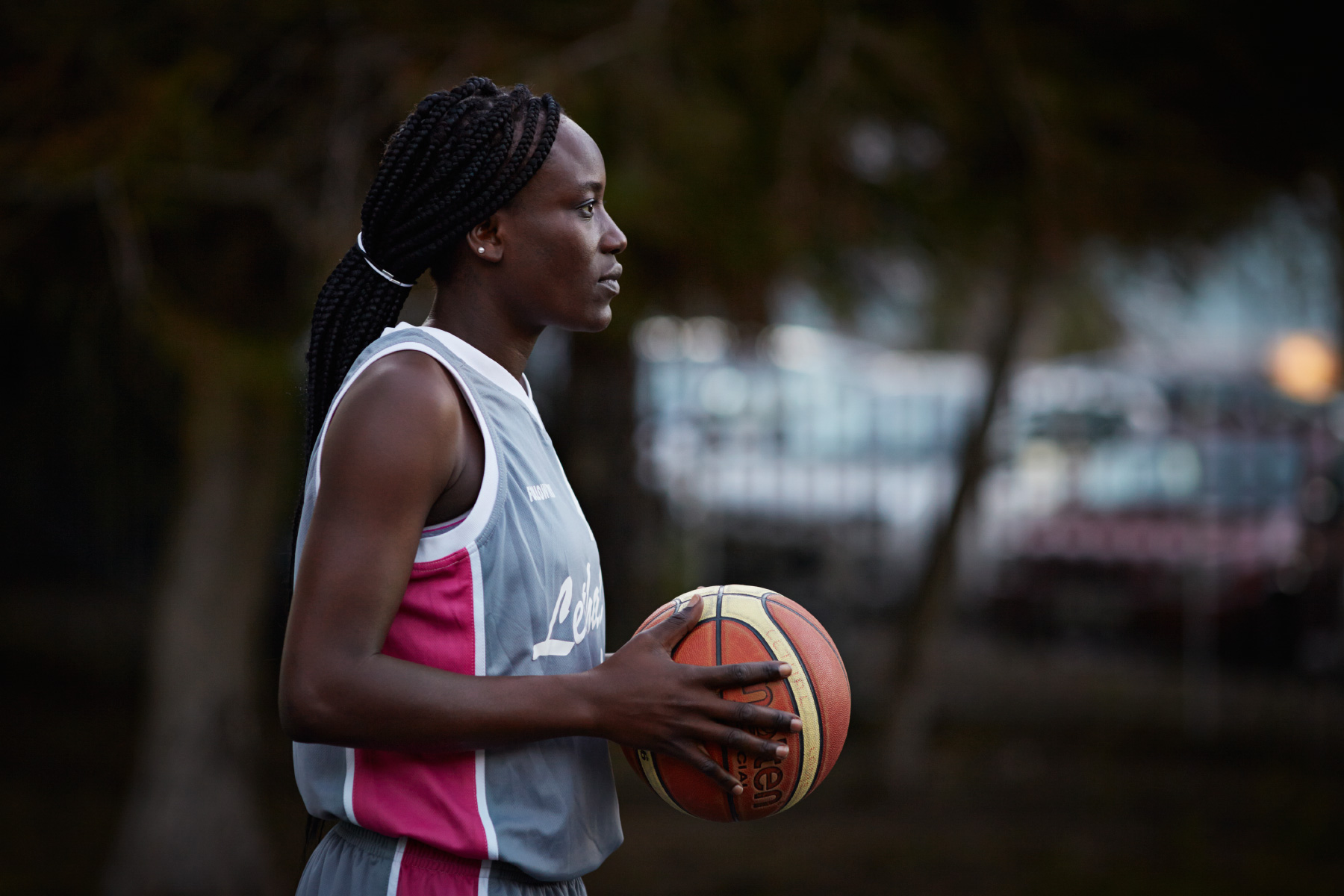 Portrait of female basket player holding ball