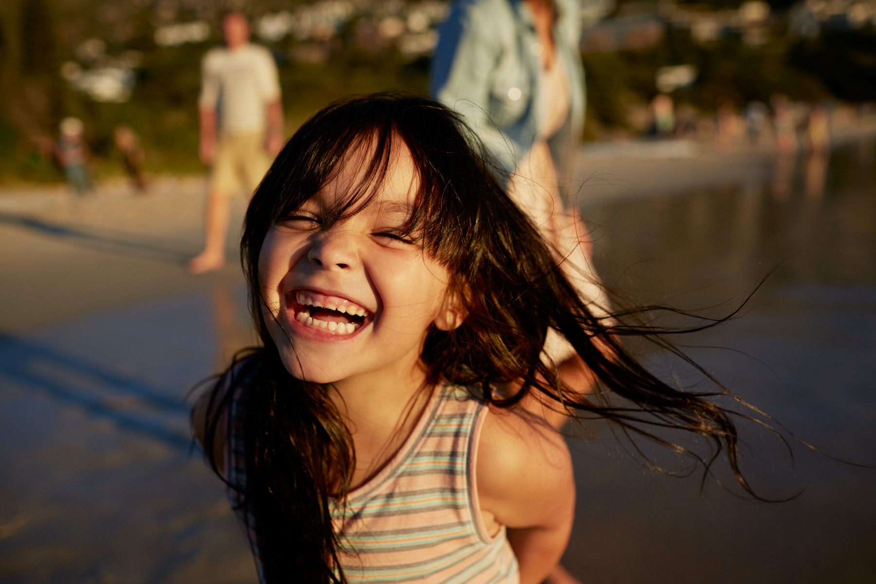 Cute little girl laughing on the beach