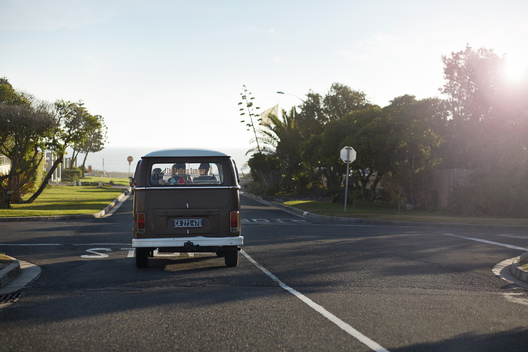 Surfers driving vintage VW bus on the way to the beach