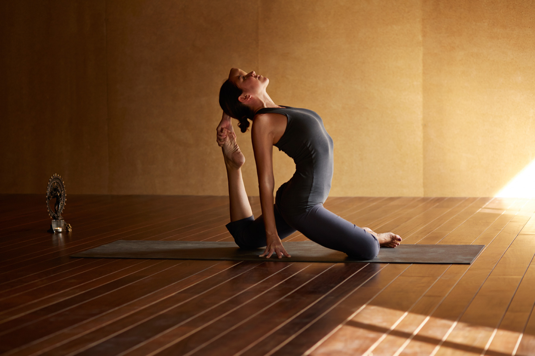 Woman doing yoga exercise in studio